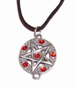 Pentagrama din metal nobil cu cristale rosii