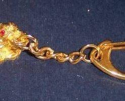 Breloc auriu - broasca raioasa cu trei picioare