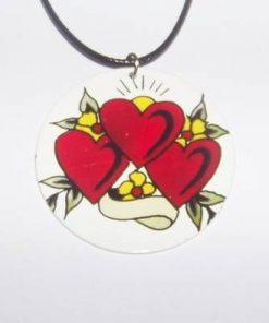 Talisman rotund, din metal, cu 3 inimi