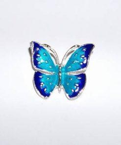 Brosa din metal nobil cu fluturele armoniei